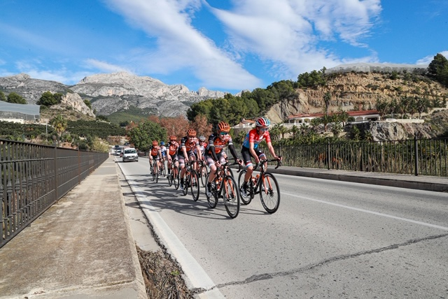 cyclists going up hill preparing for season sports catering in Javea
